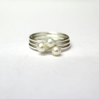 Sterling silver and freshwater pearl stacking rings.