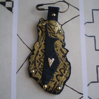 Egyptian Dog (Anubis ) in Recycled Leather.. on a pin...OOAK