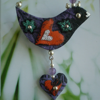 """ Blossom "" Bird Brooch in recycled Leather with Amethyst bead crest"