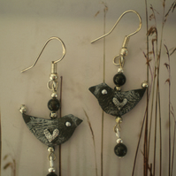 "Leather earrings .."" Bandit "" dinky bird earrings in recycled leather."