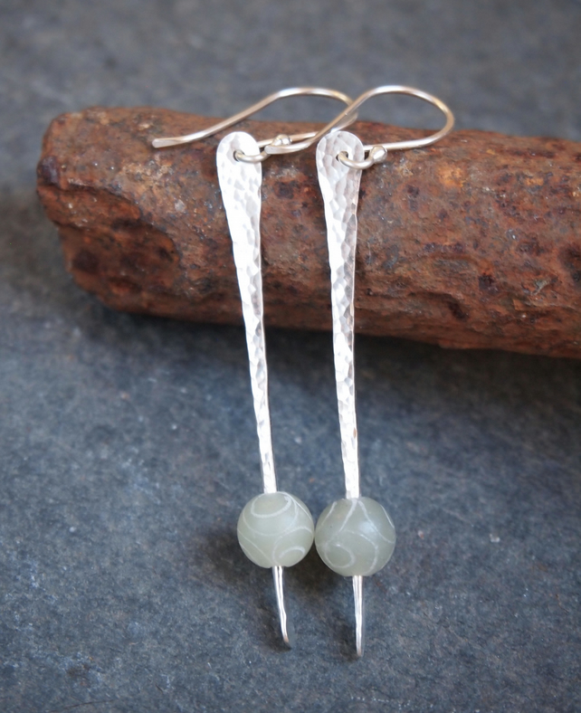 Long silver earrings, carved jade