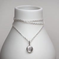 Silver pebble pendant necklace