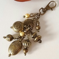 Antique Gold Bag Charm by Cool Creations