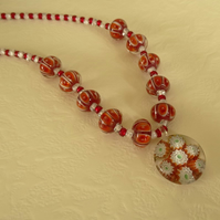 SALE - red and white glass beaded necklace with millefiori pendant