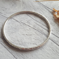 Hammered finish round silver bangle