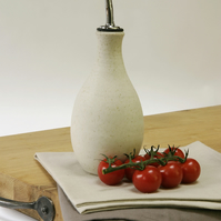 Hand thrown olive oil vinegar pourer with warm white, matt glaze and metal spout