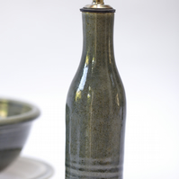 Hand thrown olive oil pourer with a smokey blue glaze and metal spout