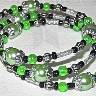Green Glass Pearls, Green, Black and Silver-tone Beads Memory Bracelet