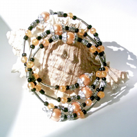 Memory Wire Bracelet of Peach Glass Pearls, Black Beads and Silver-tone Accents