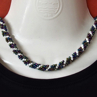 Slimline Choker: Kaleidoscopic Metalic-like & White Seed Beads in a Spiral Weave