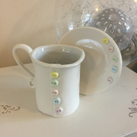 Handmade porcelain decorative tea cup and saucer with button detail