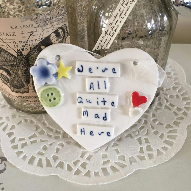 Ceramic porcelain heart plaque, We're All Quite Mad Here.
