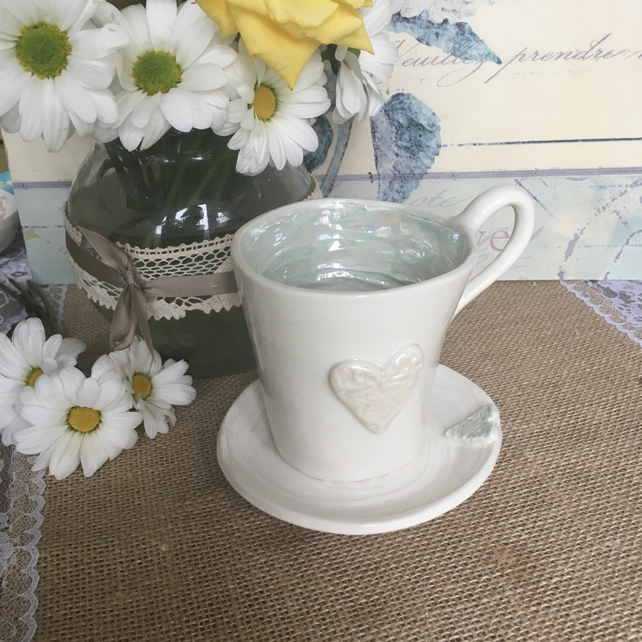 Handmade porcelain decorative tea cup and saucer with heart detail OFFER