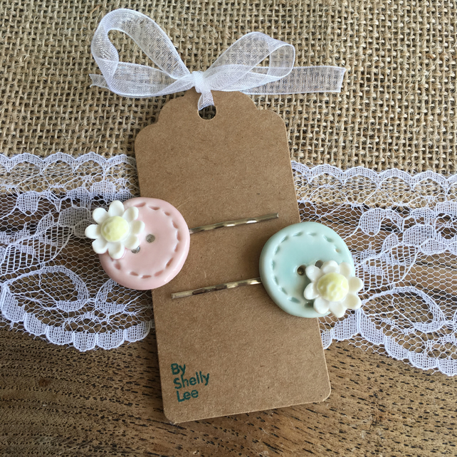 Handmade porcelain Daisy button hair slides. OFFER