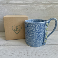 Handmade porcelain mug, sky blue mug with button detail.