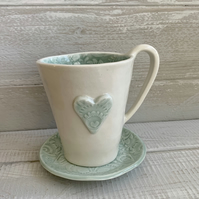 Handmade porcelain heart cup and saucer