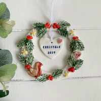Porcelain Christmas wreath decoration.