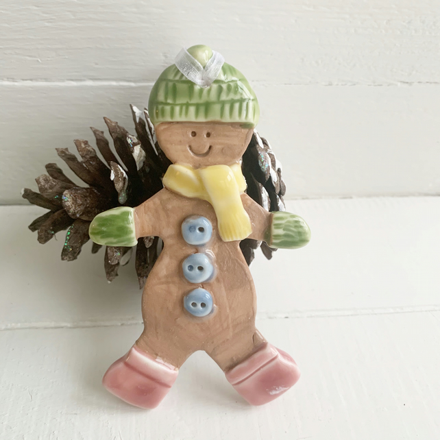 Porcelain Christmas gingerbread man decoration.