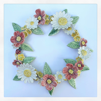 Handmade porcelain flower wreath.