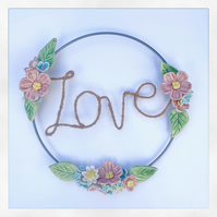 Beautiful handmade porcelain flower love wreath.