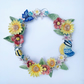 Beautiful handmade porcelain flower wreath. Summer garden