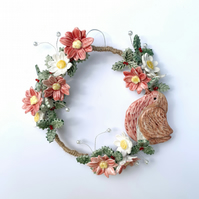 Beautiful handmade porcelain flower wreath. Christmas Robin