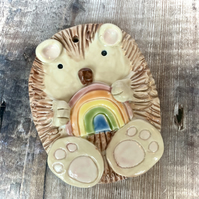 Hanging hedgehog and rainbow decoration