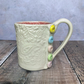 Handmade porcelain mug, double textured with button detail.