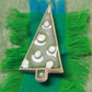 Christmas tree ceramic brooch on a gift card.