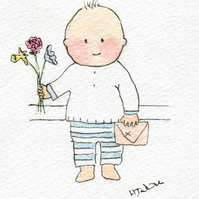 Little boy holding flowers and a card- Mother's Day.