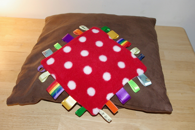 Red spotty Taggie baby comforter blanket