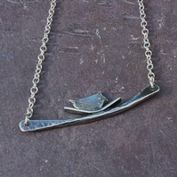 Fine silver bird in a nest on a branch pendant