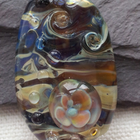 Lampworked pendant on leather thong