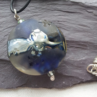 Blue lampwork pendant on leather thong