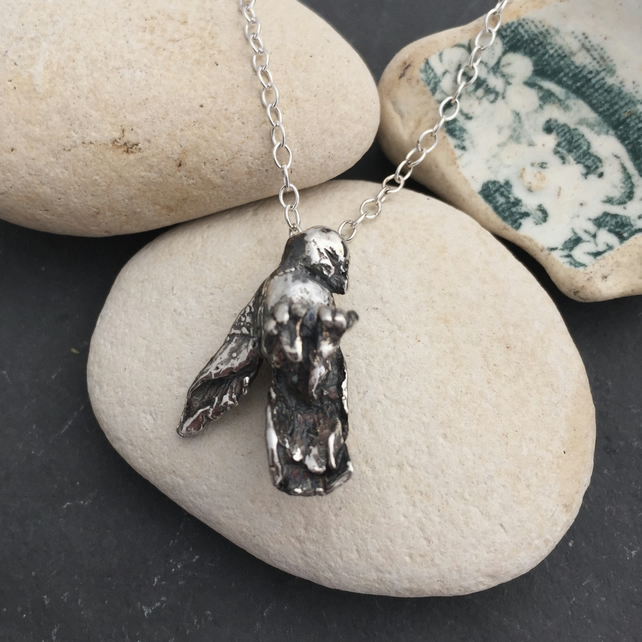 José a little 'sleeping' silver bird charm