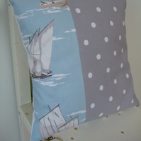 Grey spotty and sailing boat cushion