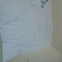 Blue birdcage cushion