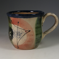 COLOURFUL SLIPWARE MUG