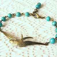 Beaded Bracelet with Bird Connector and Turquoise