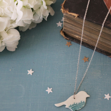 Porcelain bird necklace with lace tipped feet