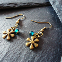'Winter Sun' Bronze snowflake and teal green glass bead earrings