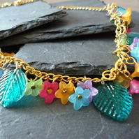 'Bouquet' gold necklace with green leaves, pink, blue, yellow and lilac flowers