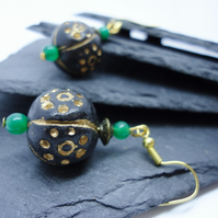 Gold patterned clay and green glass bead earrings