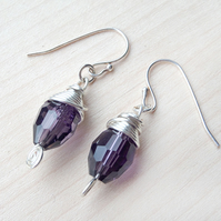 Amethyst wire wrapped crystal oval earrings.