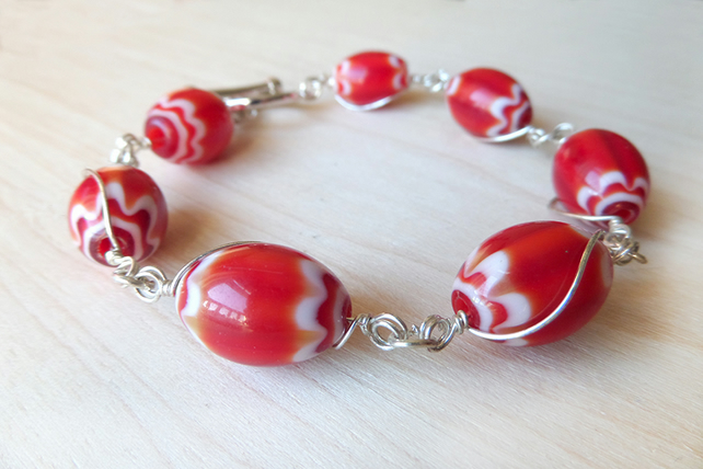 Red beaded bracelet with silver plated wire