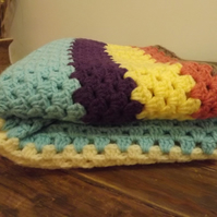 Bright and beautiful hand crocheted blanket.