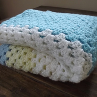 Gorgeous hand crocheted blanket with shades of blue, lemon and white.