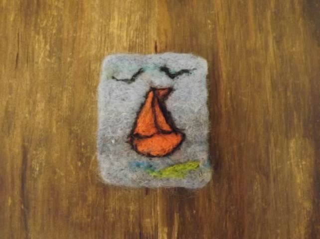 Needle felted sailing boat brooch.