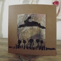 Handmade greetings card created from handmade paper and block printed hare