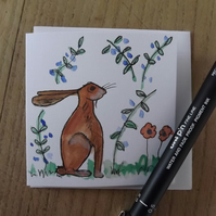 Hand drawn and Painted Sweet Little Hare in a field of flowers GreetingsCard